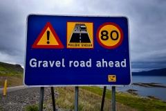 Gravel road sign island